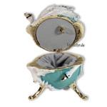 Schmuck Ei türkis mit weißen Schwänen und Spieluhr nach Faberge-Art aus emailiertem Metall