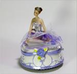 Sitzende Ballerina lila mit Spieluhr