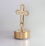 Kreuz auf goldfarbenen Sockel mit Spieluhr
